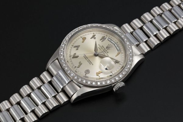 Rolex Platinum Oyster Perpetual Day-Date with diamond-set bezel and Arabic calendar and numerals, Ref. 1804