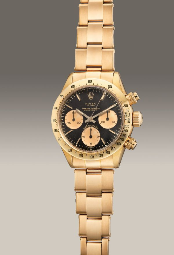 """Rolex Ref. 6265 yellow gold chronograph wristwatch with """"Oyster Split"""" dial and bracelet, circa 1975. Estimate: HK$780,000 – 1,560,000."""