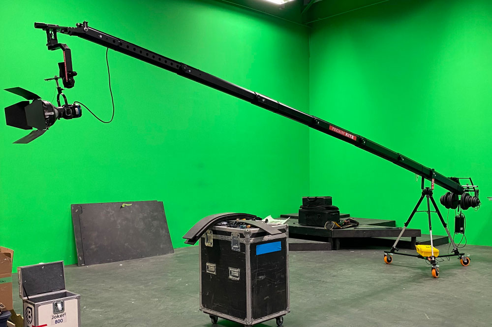 If drone and cable cams don't solve the cinematic challenge Mastermind Studios has camera cranes in-house in various sizes from smaller jibs to 26 foot cranes with 360 degree power-heads like the one shown here in our soundstage.
