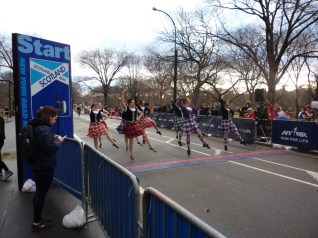 Highland dancers and a pipe band.