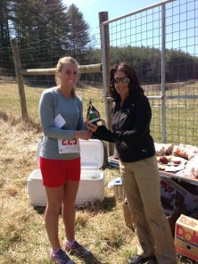 Anna Reavis receiving first place in 19 and under age group.