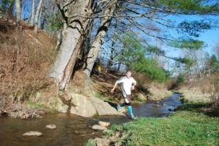 Tom Sharkey, our third place overall, jumping the creek!
