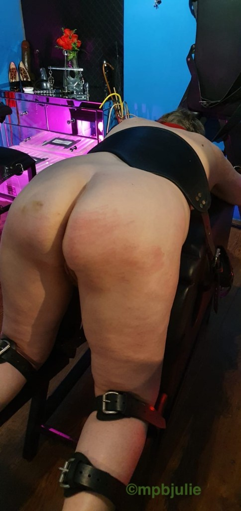 Showing my vulnerable side, bent over for impact play.
