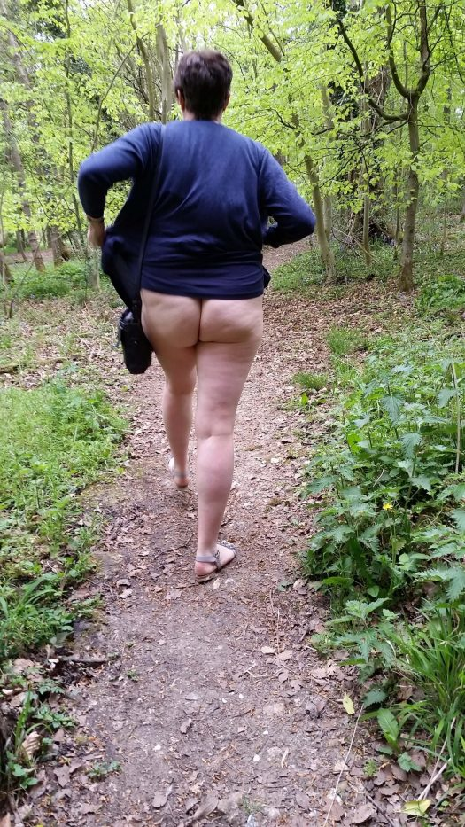 I am walking through the woods with my dress pulled up. I'm not wearing underwear