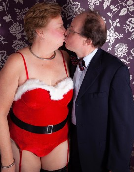 Master and I kissing at a Christmas kink event. I am dressed in a little Santa bunny girl type costume, he in a suit.