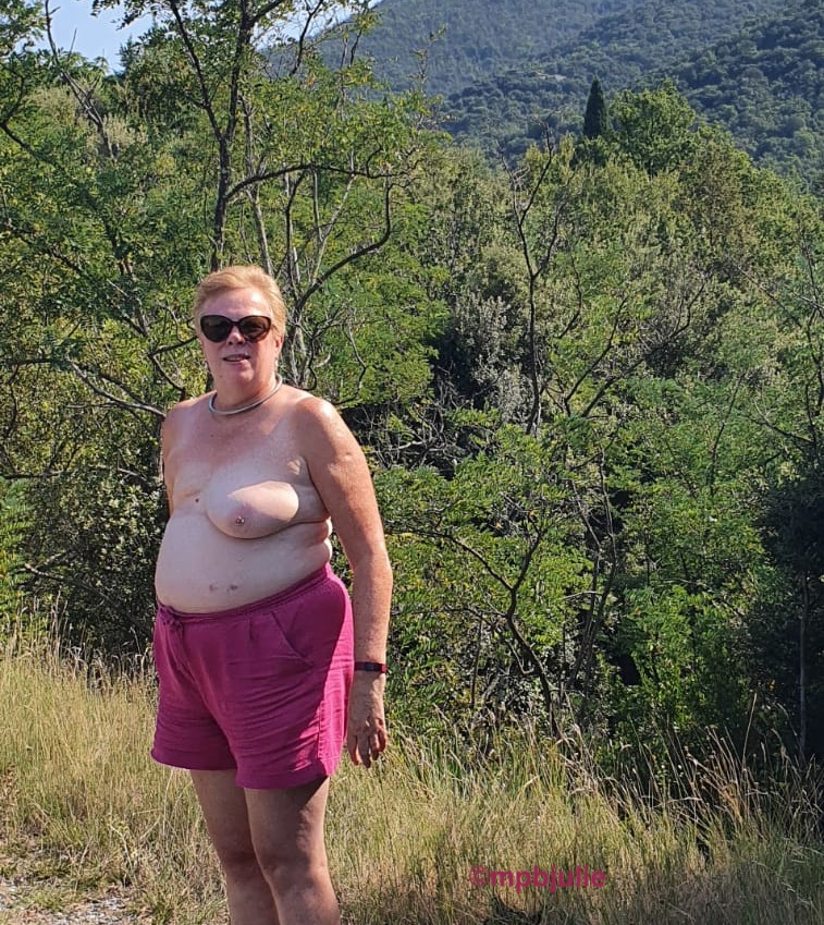 Me, topless by the roadside in the French Pyrenees. I'm wearing pink shorts