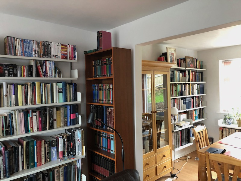 Books on the shelves - part of our living and dining room