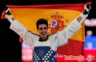 Spain's Joel Gonzalez Bonilla celebrates with a national flag after winning his men's -58kg gold medal taekwondo match against South Korea's Lee Dae-hoon during the London 2012 Olympic Games at the ExCeL arena