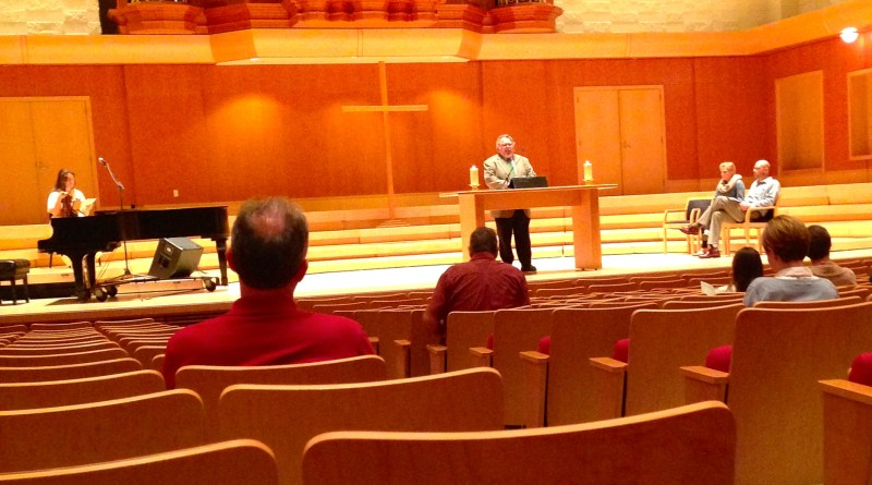 Rev. Dennis Sepper leads students, staff, and faculty in prayer during Friday's chapel service.