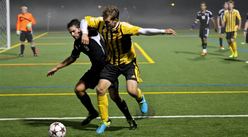 Center back Jeff Piaquadio tries to steal the ball from a Hardin-Simmons attacker on Sept. 14.