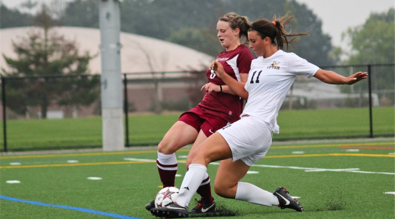 Kaylie Rozell slides into a Puget Sound player during their game on Sept. 14.