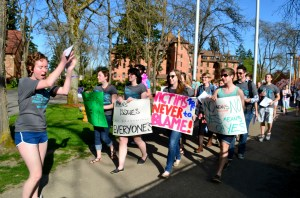 "Sophomore Audrey Lewis leads participants in ""radical cheers"" against sexual assault as they march around campus at the events Take Back the Ngiht and Walk a Mile in Her Shoes on April 25."
