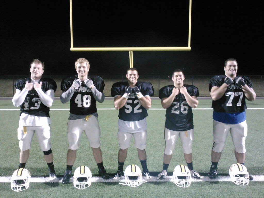 The four Lute football players surrounding Bobby Daly, 52, have persuaded him to stick with football, even in dire circumstances. They have stood by him every step of the way. From left to right, seniors Dalton Darmody, Jordan Patterson, Daly, Ben Kaestner and Mychael Tuiasosopo. Photo by Sam Horn.