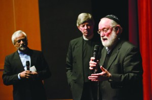 Imam Jahmal Rahman (left), Pastor Don Mackenzie (middle) and Rabbi Ted Falcon (right) discuss the five stages of interfaith dialogue Wednesday evening in the Phillips Center.