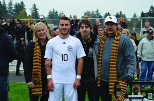 Senior Giancarlo Santoro's family members surround him during Senior Day. From left to right: mother, Theresa Santoro; brother, Dante Santoro; father, Vincent Santoro. Photo courtesy of Giancarlo Santoro.