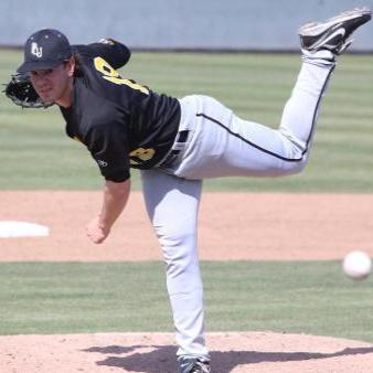Pitcher Trevor Lubking, a junior, hurls a pitch during an away game this past season. This 2014 season proved to be a successful year for Lubking, as he won six games and only allowed 21 earned runs in 13 appearances. Photo by Jesse Major.
