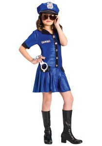Photo Credit by Creative Commons Example of a police officer costume for young girls. The young girls costume is used with shiny material also the the amount of skin revealed compared to many boys costumes is greater.