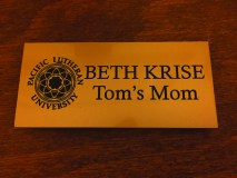 Beth Krise's gold name tag, President Krise posted on his Facebook wall in July.
