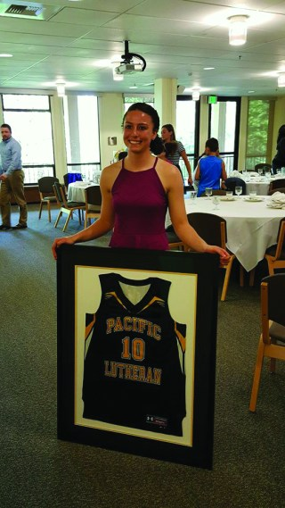 Abdo at basketball banquet with her framed jersey.