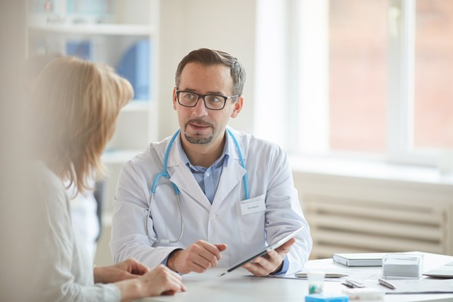 male-doctor-with-nurse-at-office-UN94ZUU
