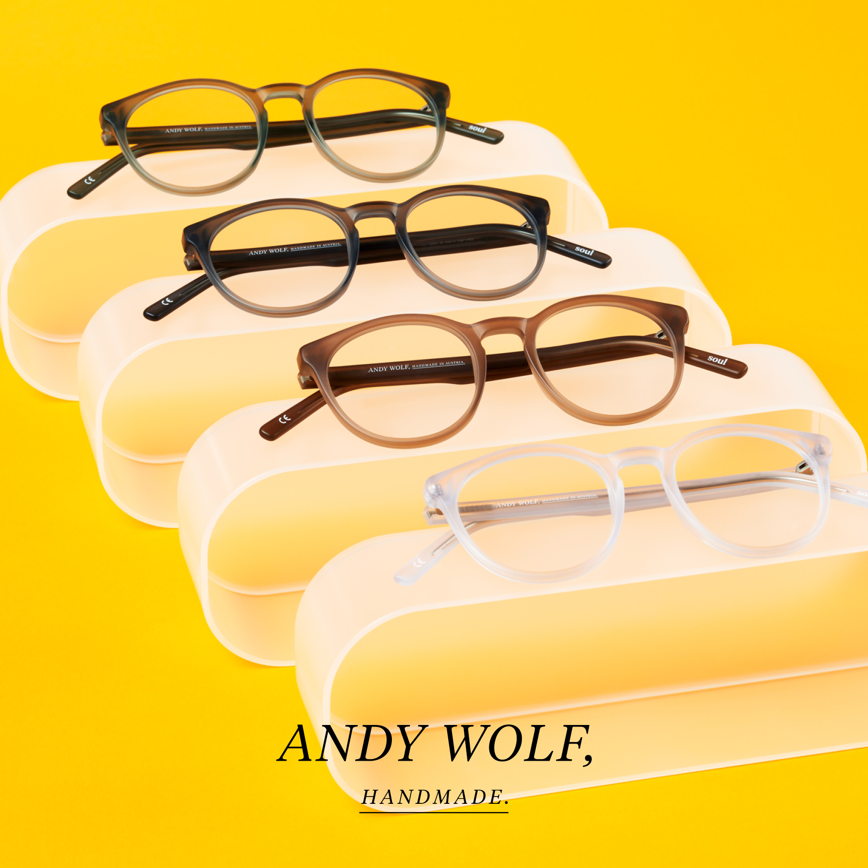 Beautiful hand made eyeglasses by Andy Wolf yellow background