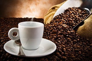Coffee smoking on the coffee beans background