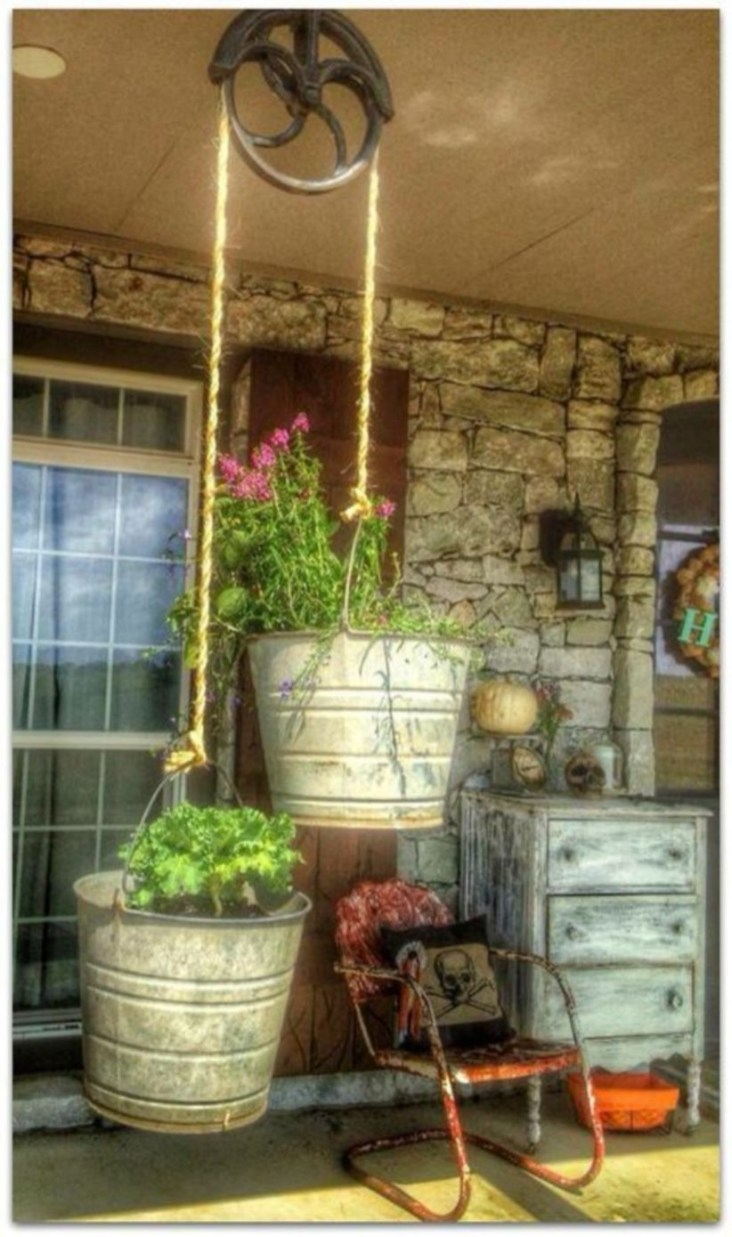 Charming outdoor hanging planters ideas to brighten your yard 41