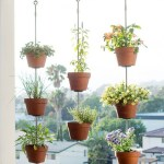 Charming outdoor hanging planters ideas to brighten your yard 43