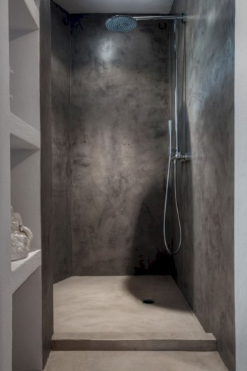 Nice and minimalist bathroom with the glass wall with a concrete 06