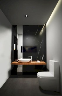 Nice and minimalist bathroom with the glass wall with a concrete 11