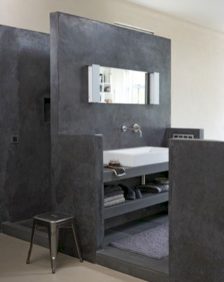 Nice and minimalist bathroom with the glass wall with a concrete 15