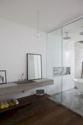 Nice and minimalist bathroom with the glass wall with a concrete 18