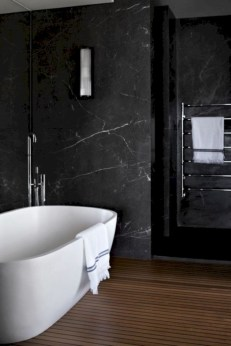 Nice and minimalist bathroom with the glass wall with a concrete 20