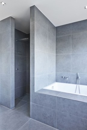 Nice and minimalist bathroom with the glass wall with a concrete 24