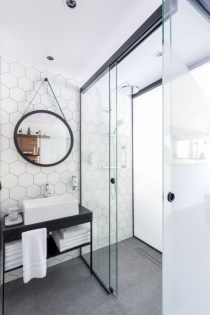 Nice and minimalist bathroom with the glass wall with a concrete 36