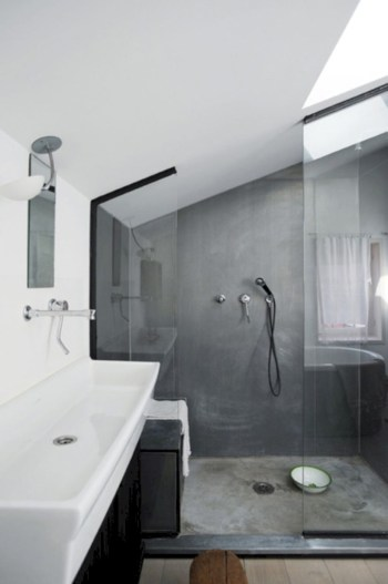 Nice and minimalist bathroom with the glass wall with a concrete 37