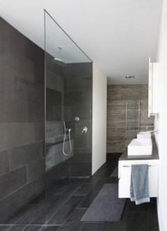 Nice and minimalist bathroom with the glass wall with a concrete 41