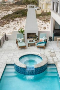 Pool waterfalls ideas for your outdoor space 12