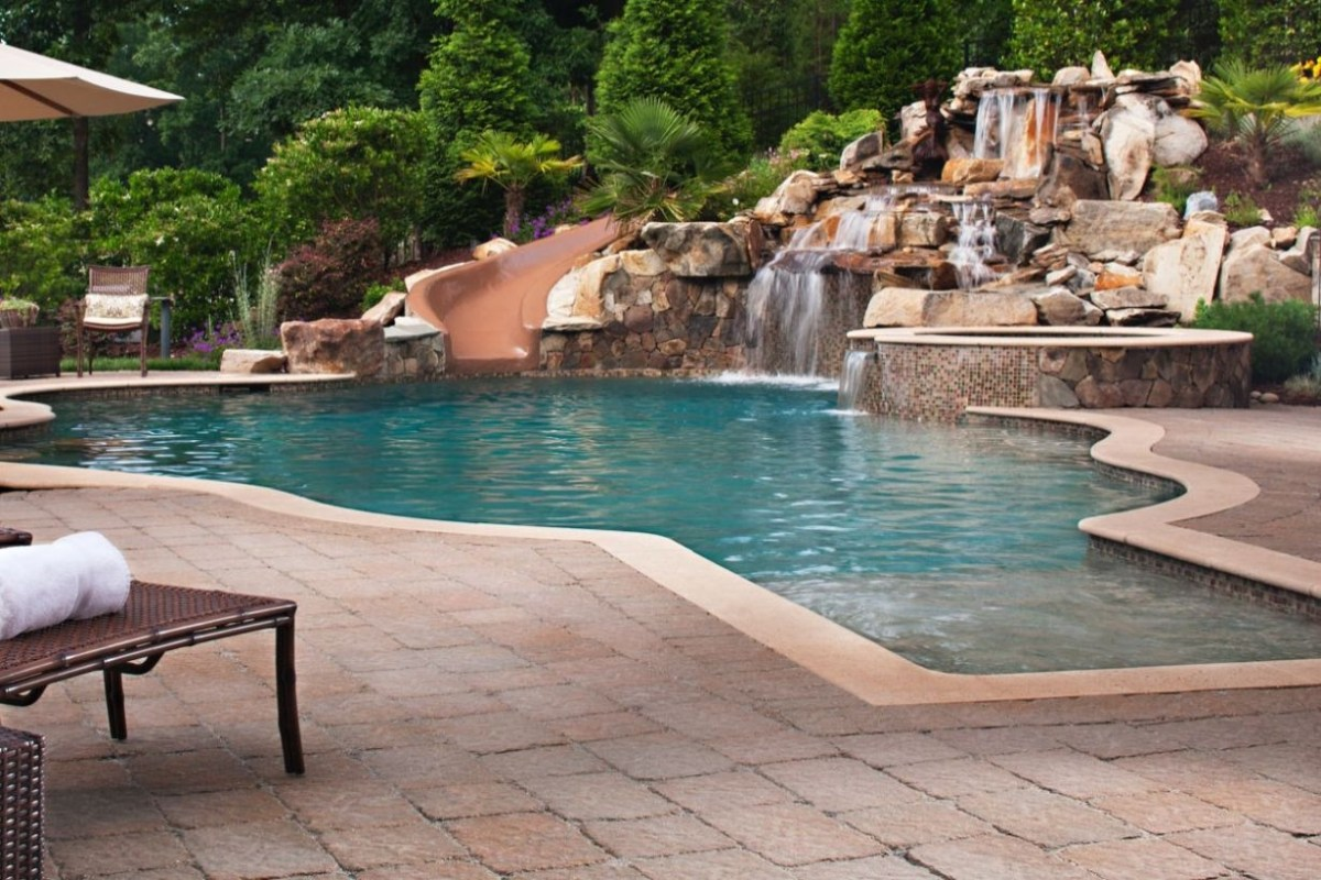 Pool waterfalls ideas for your outdoor space 26