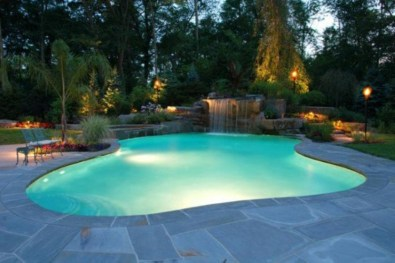 Pool waterfalls ideas for your outdoor space 32