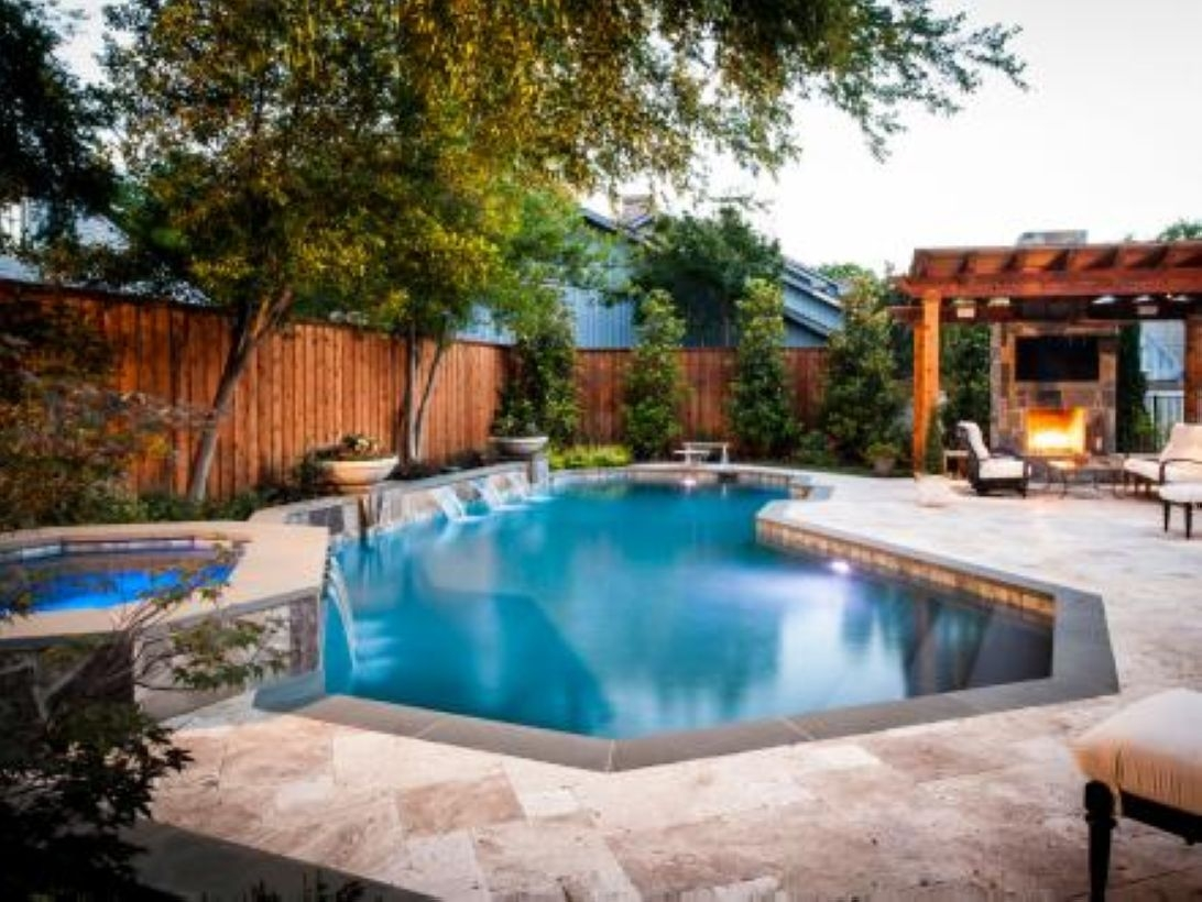 Pool waterfalls ideas for your outdoor space 34
