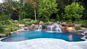 Pool waterfalls ideas for your outdoor space 36