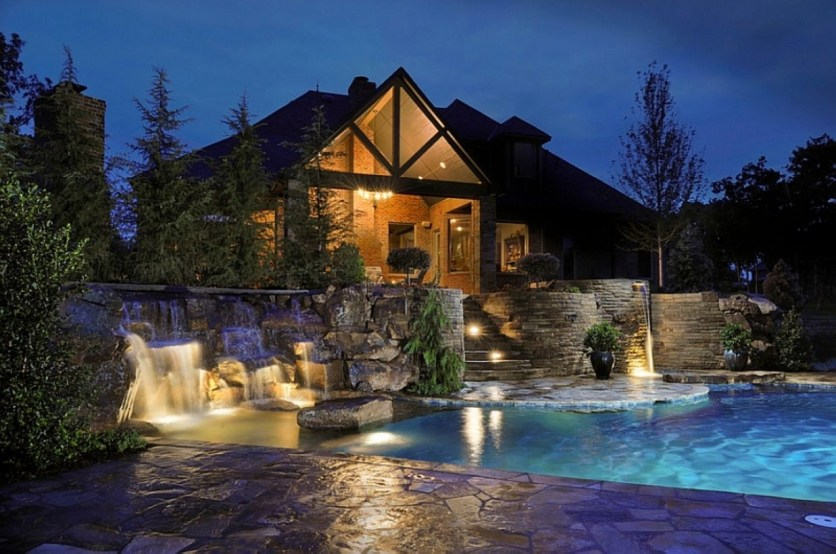 Pool waterfalls ideas for your outdoor space 39