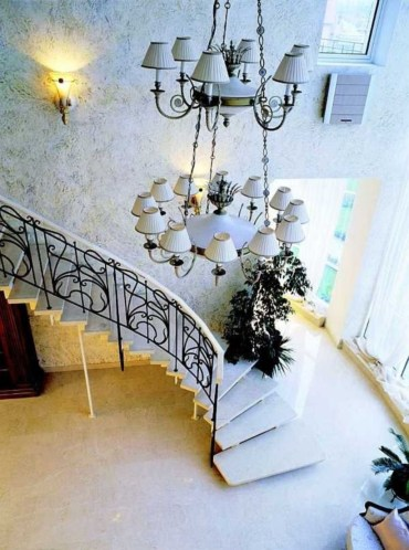 Ways to decorate with chandelier over the stairs 22