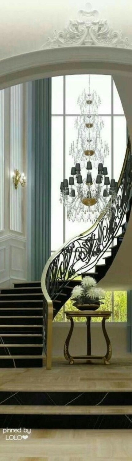 Ways to decorate with chandelier over the stairs 38