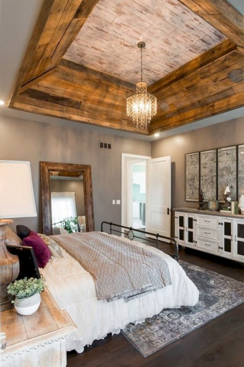 Bedroom with barnwood ceiling using wood