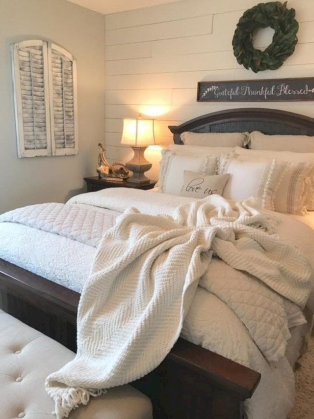 Bedroom with shiplap wall