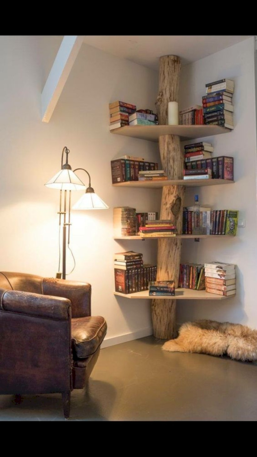 Bookshelf teamed with floor lamp and leather armchair