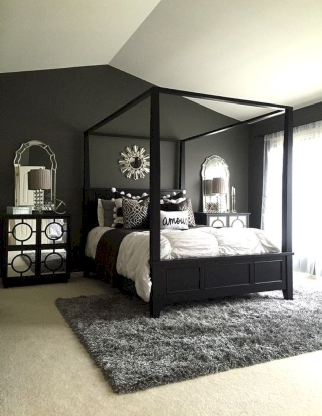 Cozy rug, patterned pillows, lamps, and mirrors in the bedroom