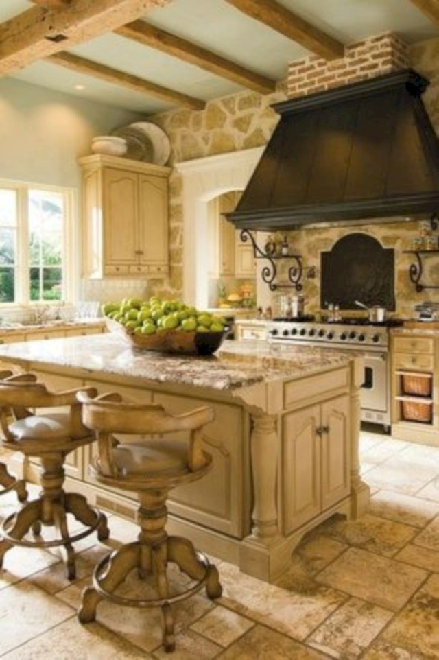 Kitchen with granite countertops and travertine floor